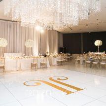 monogrammed dance floor, white decor, chandelier