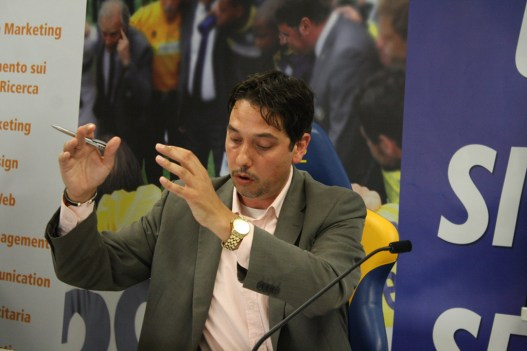 Elliott King speaking at a Televised event in Parma, Italy