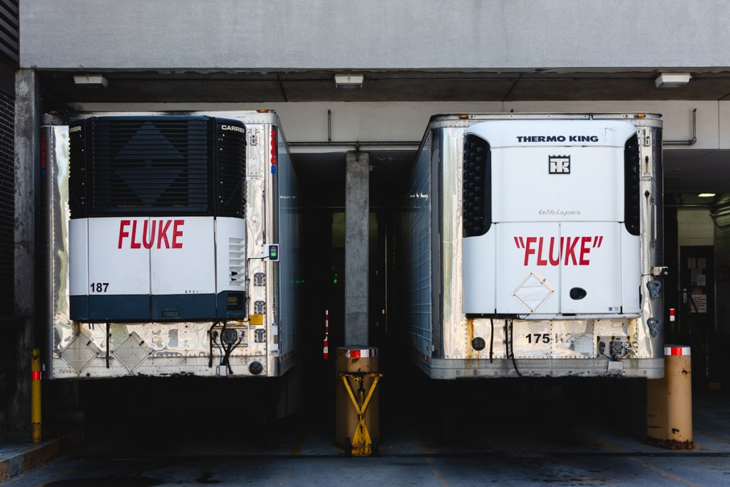 Two tractor trailers both labeled FLUKE