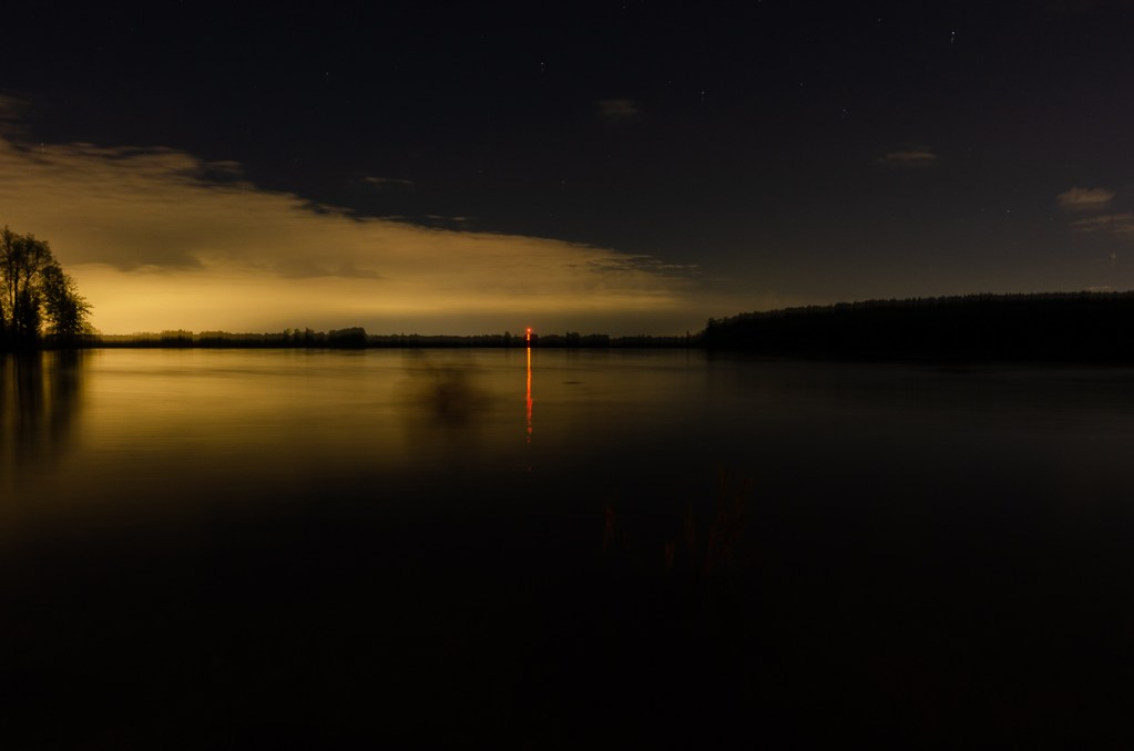 A long exposure image of a lake at night.