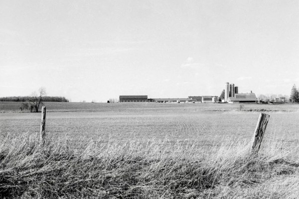 A monochrome landscape of a farm in Ontario