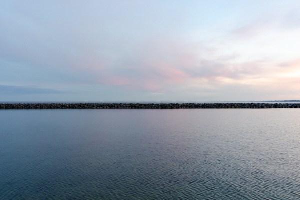A minimal landscape image of Lake Ontario.