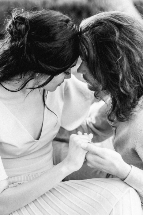 Couple in in love in black and white Chic lakeside proposal
