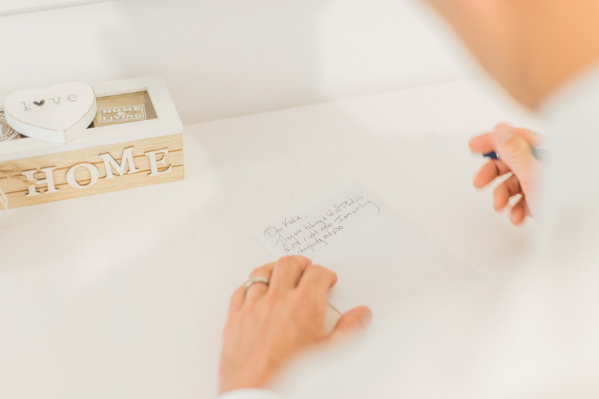 Hellenic Chic Elopement groom writing vows