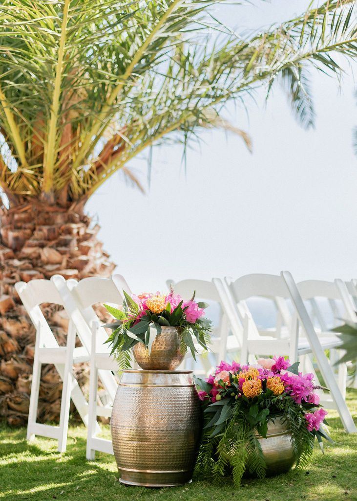 chairs at he ceremony overlooking the sea at the Fun and colorful modern island wedding