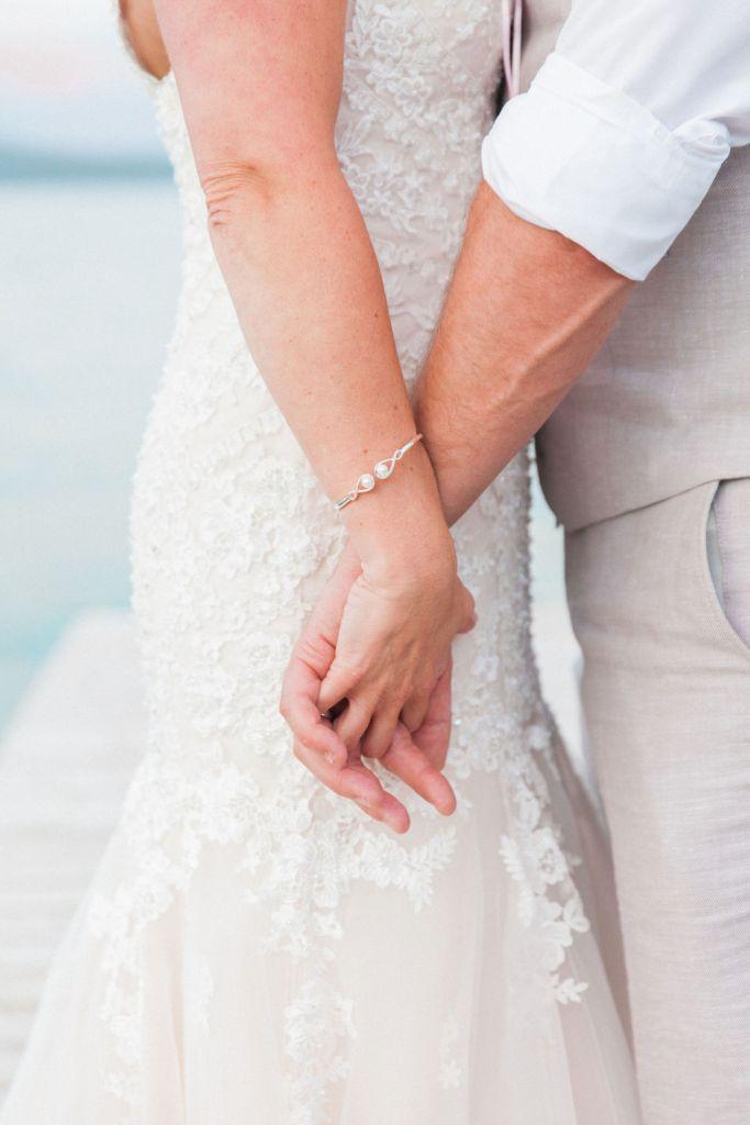 Holding hands at Romantic Greek Island Destination Wedding
