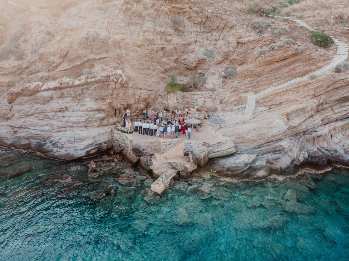 Wedding ceremony on the rocks with guests from around the world
