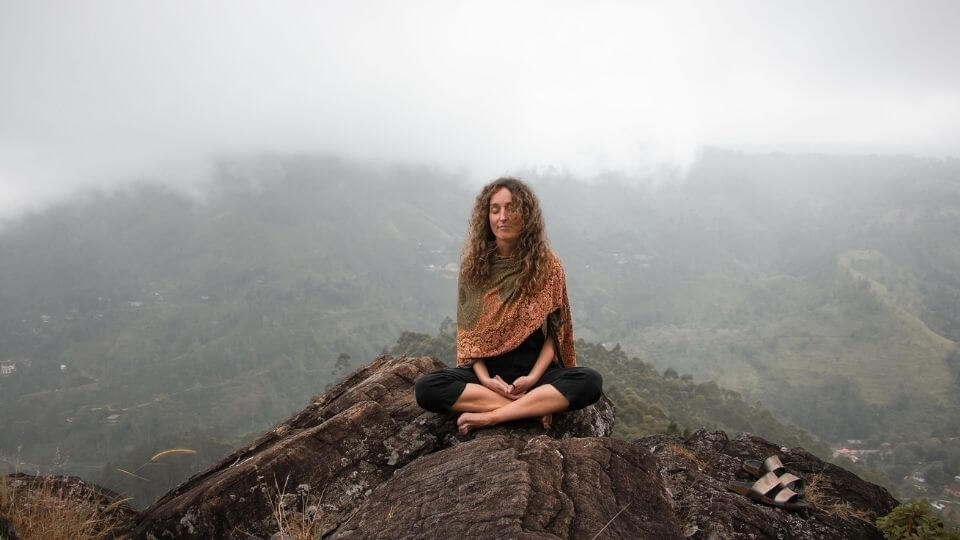 Relaxation techniques for stress-connect with your spiritual side-woman meditating on mountain