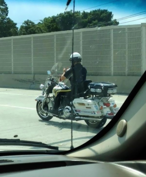 My Friend Took This Yesterday. Yes, That Is A Police Officer Texting While Driving A Motorcycle