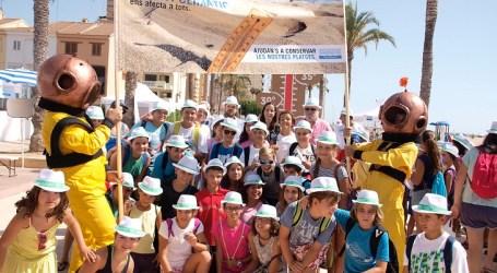 Prop de 200 xiquets participen a la Fira de Sensibilització Ambiental a la platja de La Pobla de Farnals