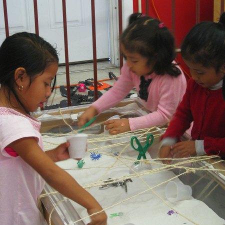 pre-k children making sand art