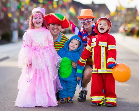 trick-or-treaters with parents