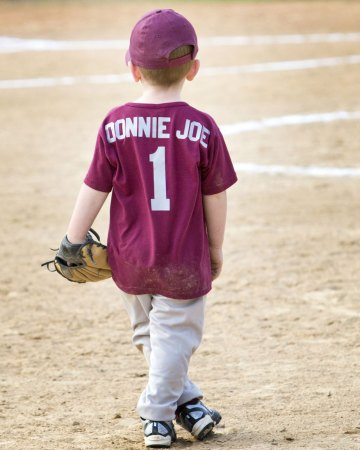 toddler boy playing little league