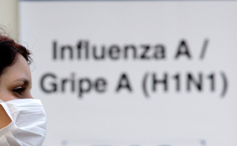 A person with a suspected case of H1N1 influenza virus waits outside Miguel Couto hospital in Rio de Janeiro