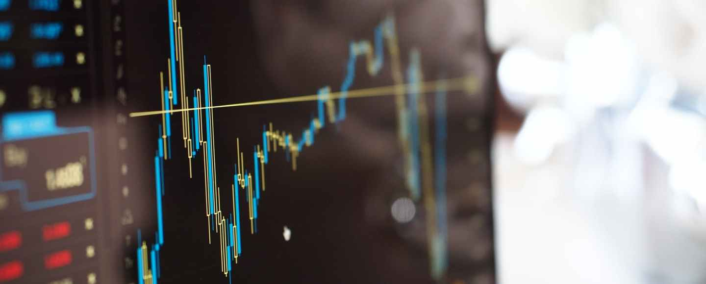 blue and yellow graph on stock market monitor