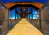 Zooming Bridge by Elmore Photography