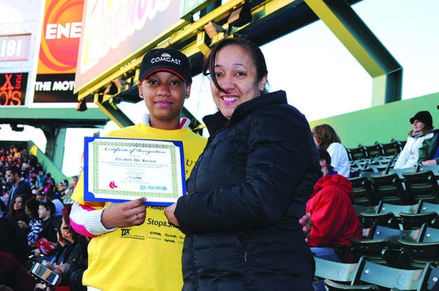 ➥➥ Proud mom at Fenway Park with her daughter Elizabeth Del Rosario from the Browne School in Chelsea who received a recognition for academic success.