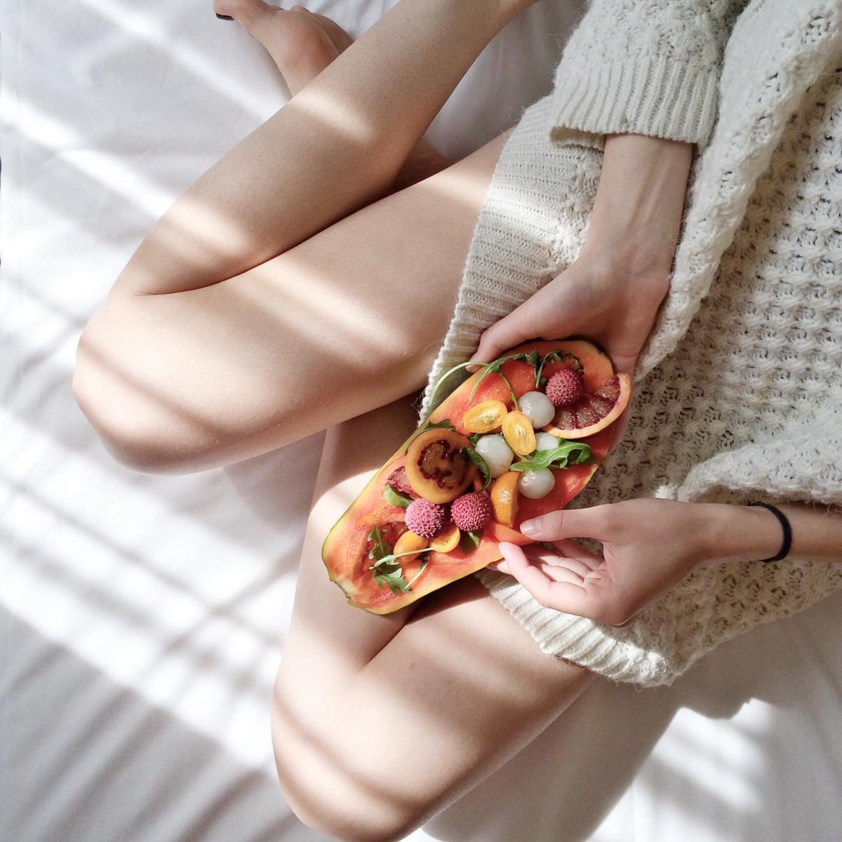 person-holding-papaya-fruit-on-bed-1030870 (1)