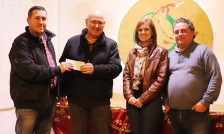 La Asociación D'Genes recibe la recaudación del concierto de pasodobles benéfico