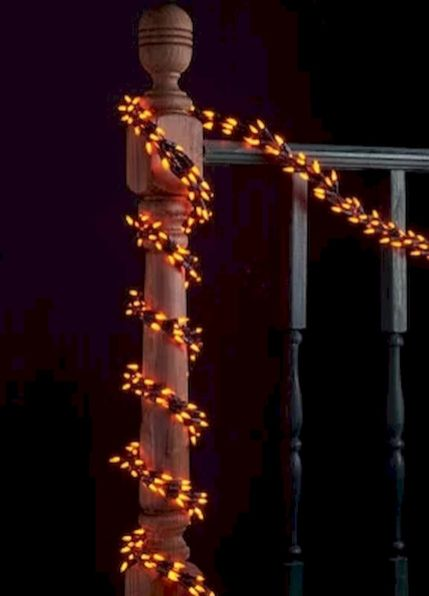 Mystical Halloween Lighting Ideas with Spellbinding candle and light string effect Part 69