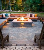 Modern outdoor living area with cozy furniture and firepit Part 15