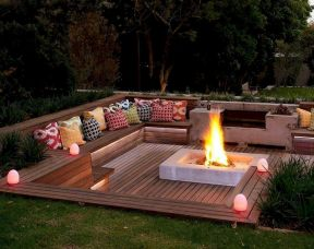 Modern outdoor living area with cozy furniture and firepit Part 21