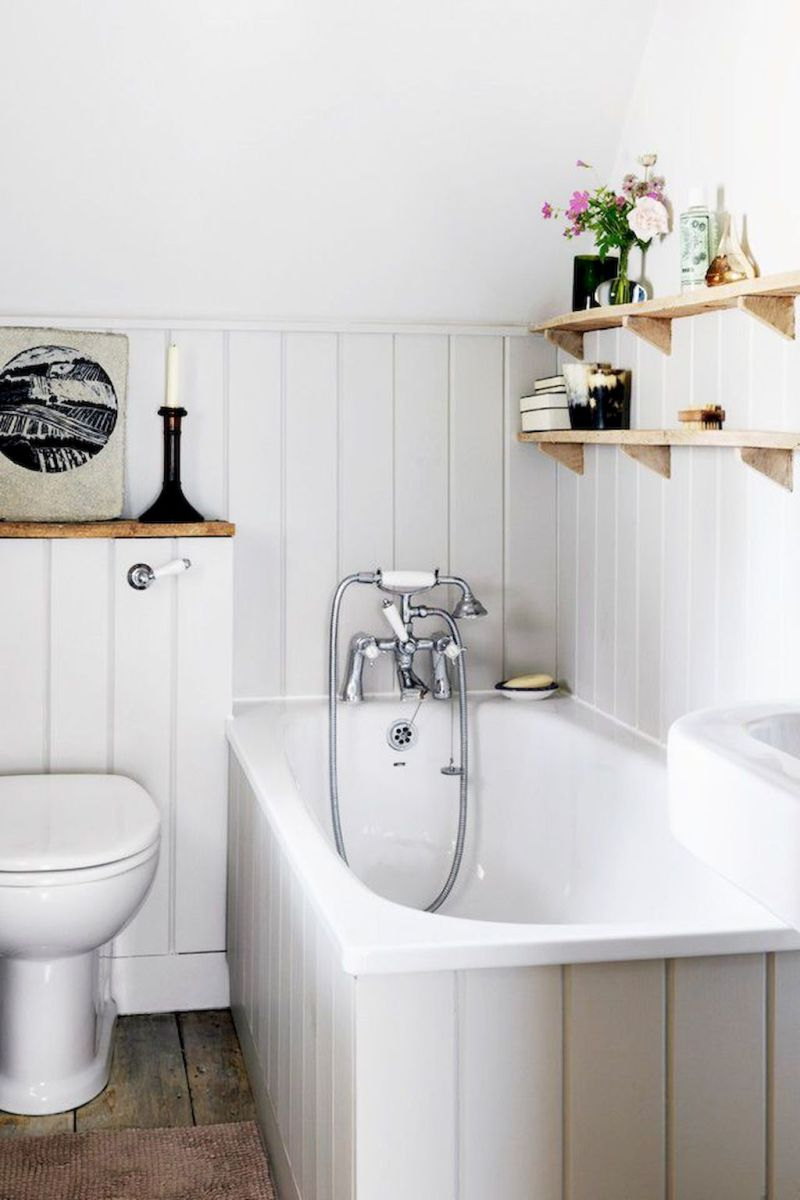 Open shelving at end of a bathtub for more efficient bathroom organization Part 36