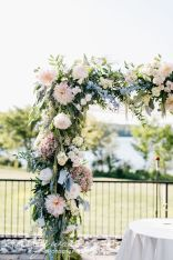 Refreshing spring wedding garland with green pink peach and ivory color themes over the walls wedding arch and tables Part 21