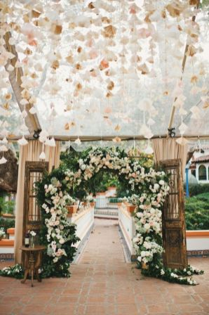 Refreshing spring wedding garland with green pink peach and ivory color themes over the walls wedding arch and tables Part 24