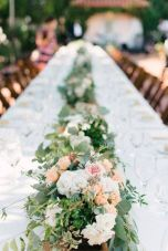 Refreshing spring wedding garland with green pink peach and ivory color themes over the walls wedding arch and tables Part 28