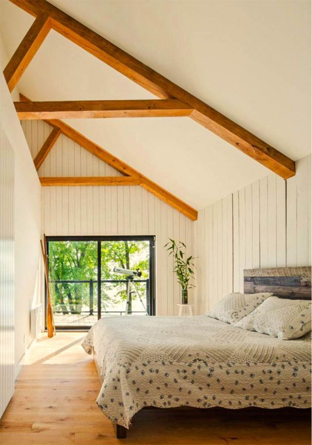 Cozzy bedroom arrangement in Saint Placide Chalet that ensures the family get the best staying experience