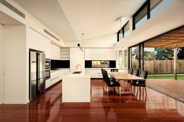 Large glass window and wall granting maximum sun exposure to highlight rich wood color in the glossy finish (2)