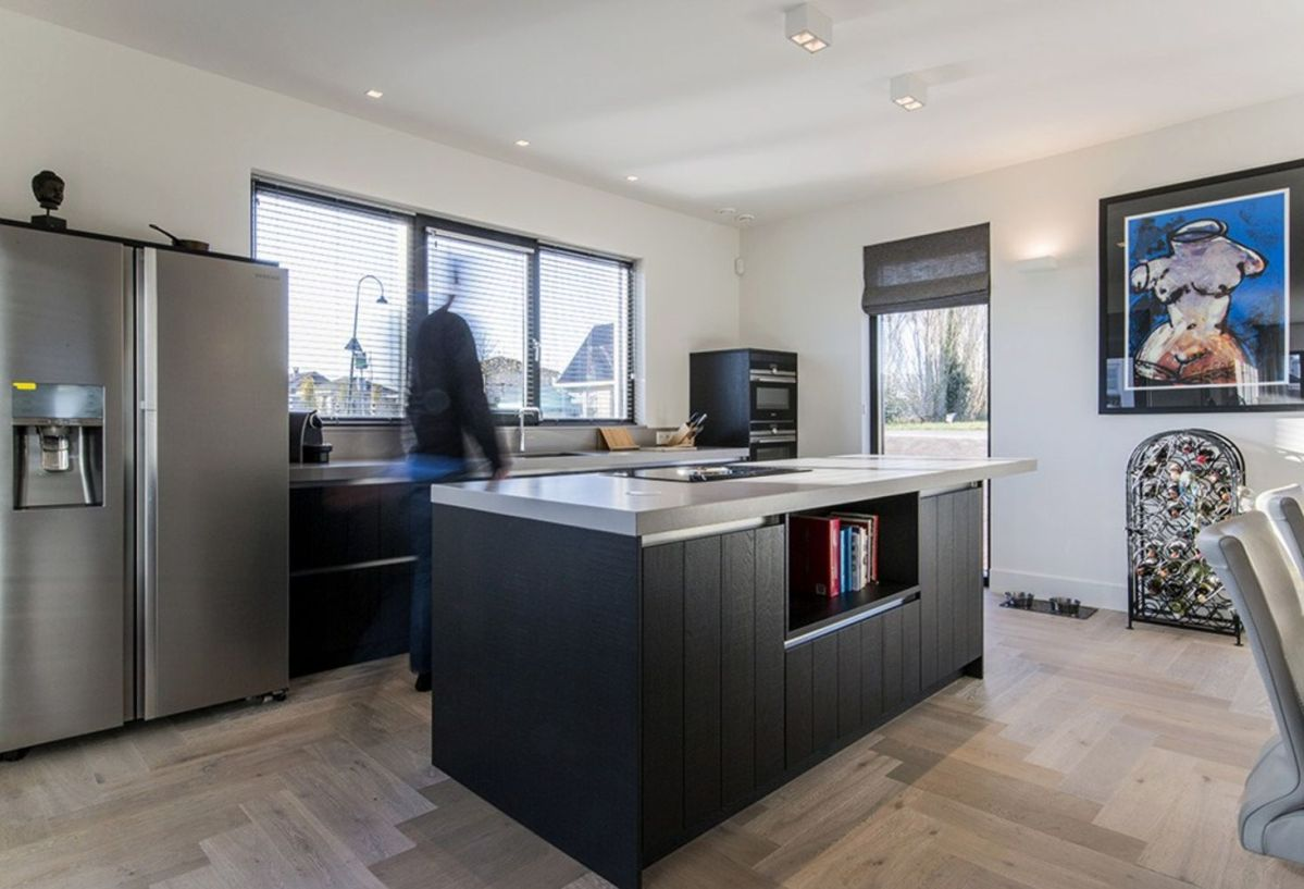 Black white barn house design showing open interior concept with seamless modern home characteristics Out Of The Box (3)