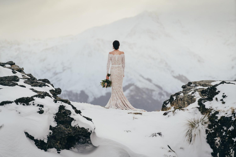 Cecil Peak winter wedding Queenstown, bride on The Ledge