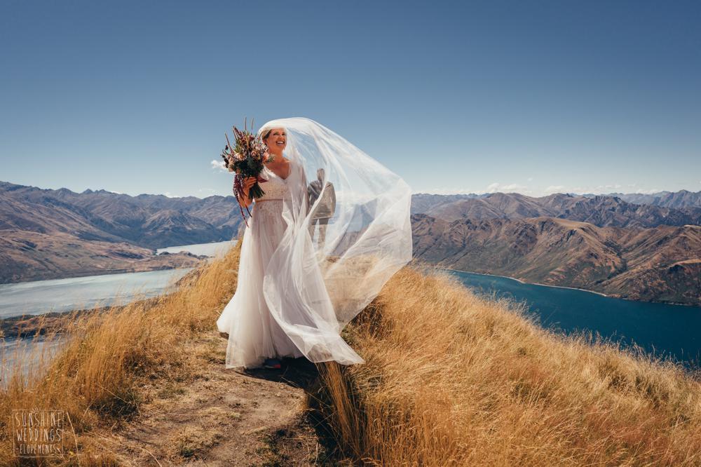 Bride and veil on Coromandel Peak in New Zealand