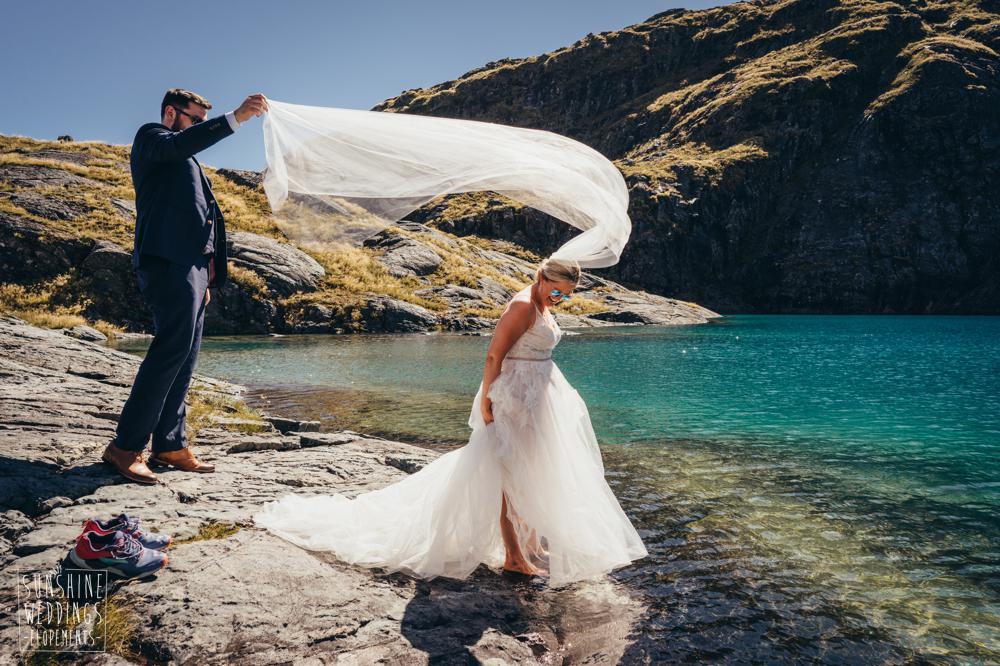 bride and groom holding veil lake erskine southern alps