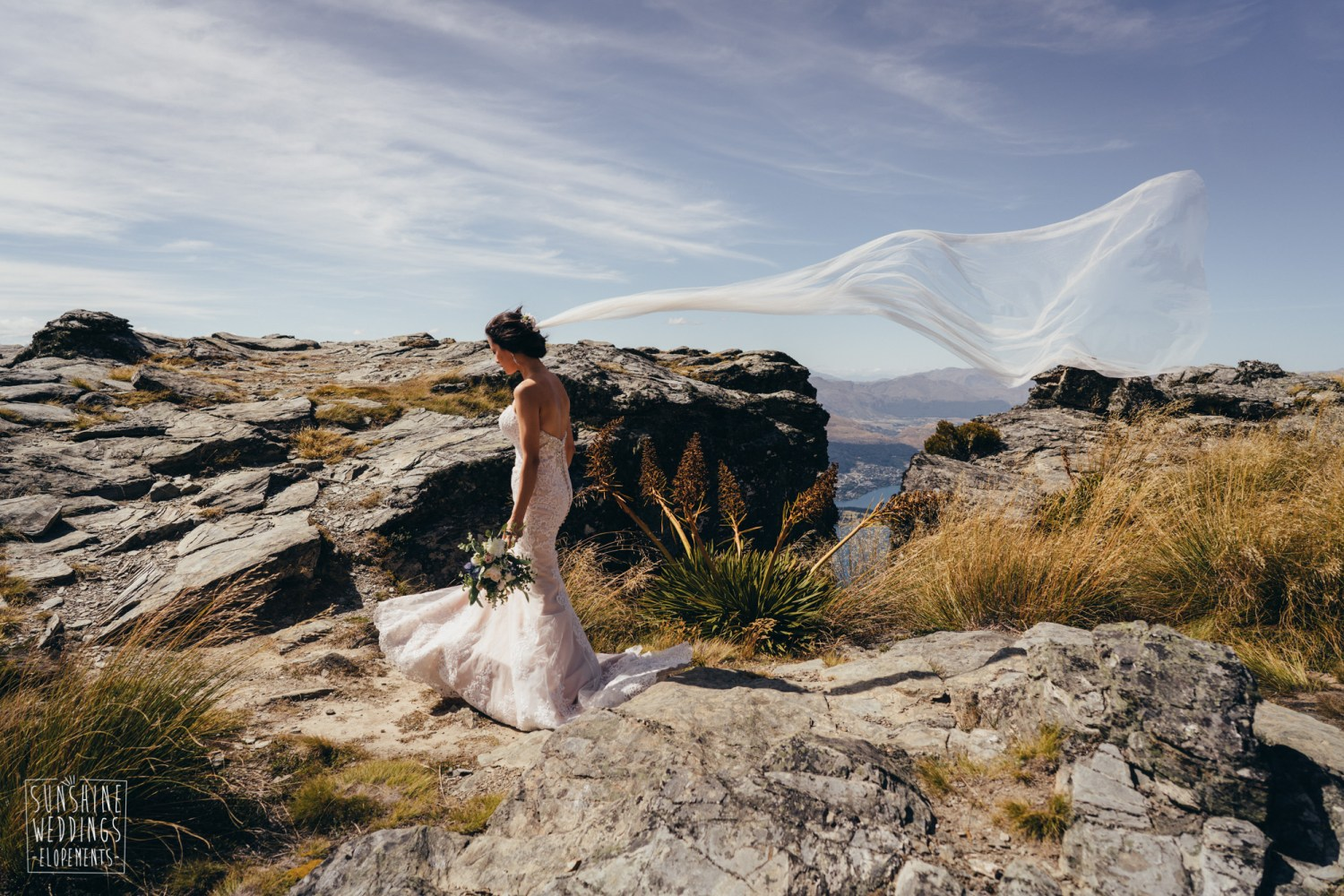 bride and veil in wind on a mountain wedding in New Zealand