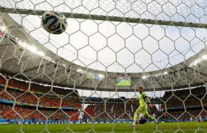 Robin van Persie of the Netherlands heads to score past Spain's Casillas during their 2014 World Cup Group B soccer match at the Fonte Nova arena in Salvador