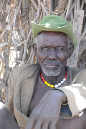 Turkana man, sitting in the shade. Probably half as old as he seems