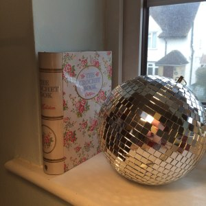 Disco ball and crochet book