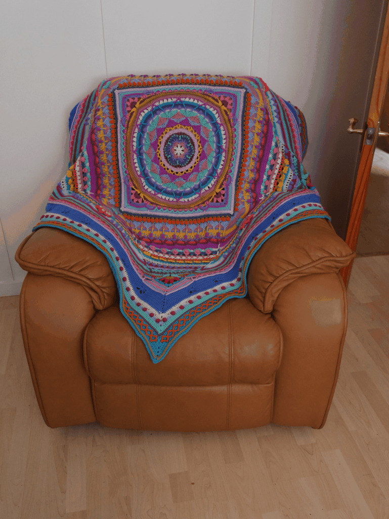 Sophie's Universe blanket on an armchair