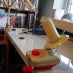 Red and cream yarn winder on desk