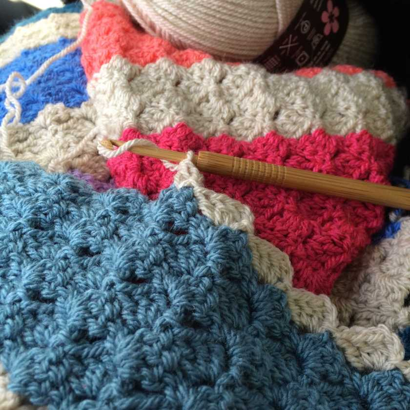 Corner to corner crochet blanket on a train