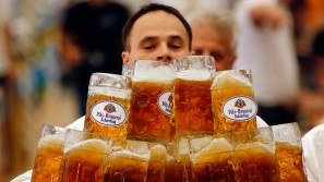 German Oliver Struempfl competes to set a new world record in carrying one liter beer mugs over a distance of 40 m (131 ft 3 in) in Abensberg September 7, 2014. Struempfl carried 27 mugs over 40 meters to set a new record for the Guinness book of records.