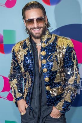 El cantante colombiano Maluma fue registrado este domingo a su llegada a la alfombra azul de los Premios Juventud 2018, en el Watsco Center de Coral Gables (Florida, EE.UU.). EFE