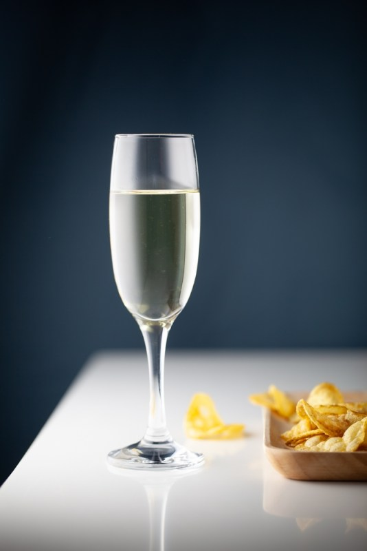 Glass of white wine with crisps