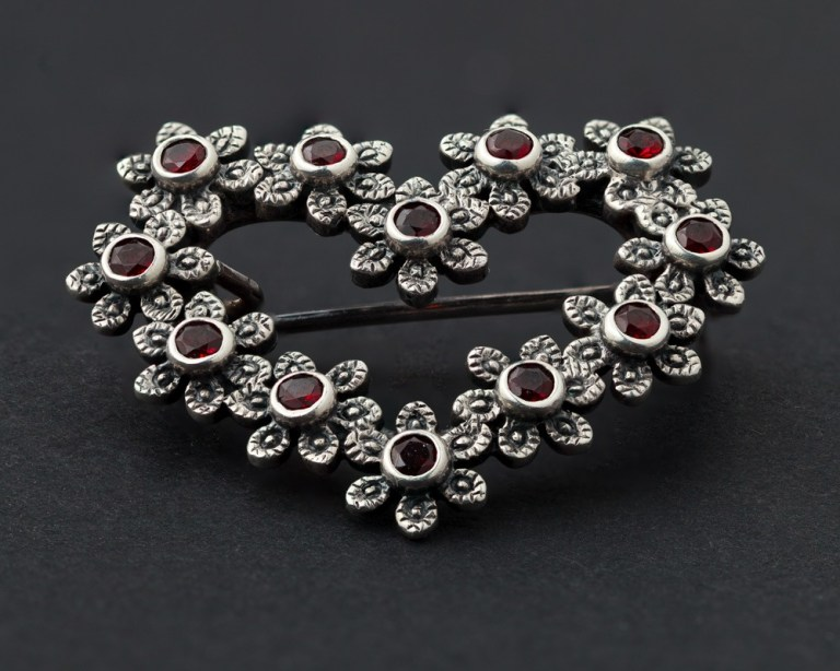 Vintage brooch with sharp focus on black background
