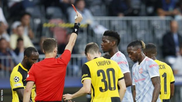 Aaron Wan-Bissaka is shown a straight red card during Manchester United's Champions League defeat to Young Boys