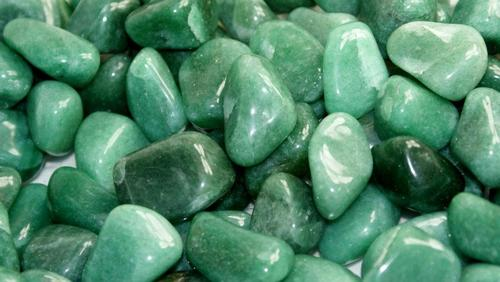 """The name Aventurine comes from the Italian word ventura, which means """"by chance.""""  It alludes to the way a glass pattern was discovered that resembles the stone later given this name. -- Green Aventurine Meaning"""