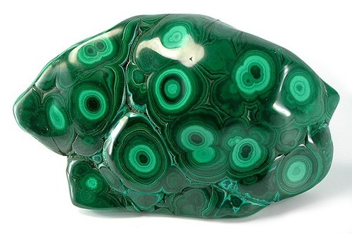 """Some malachite comes with unique light green bands that can sometimes form an eye-shaped design.   These are called """"eye stones"""" and are especially potent when it comes to amplifying visions and creating wards of protection.  -- Malachite Metaphysical Properties"""
